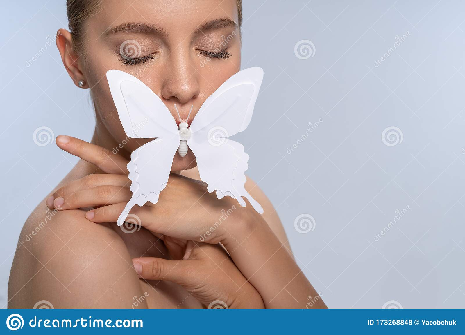 Tender Young Woman Keeping Eyes Closed During Shooting Stock Photo