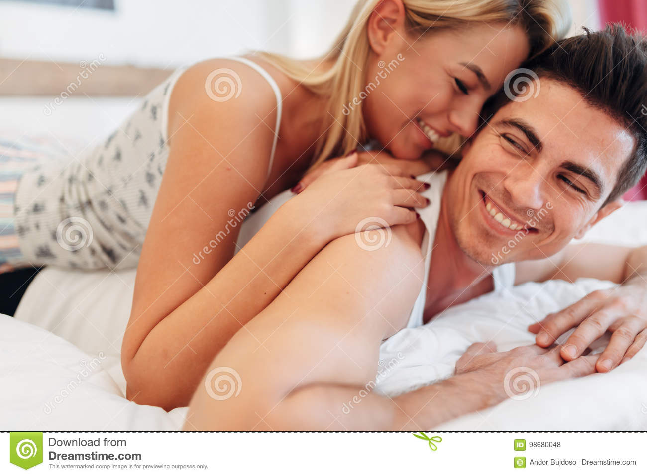 Tenderness Od A Beautiful Couple In Bedroom Stock Image of