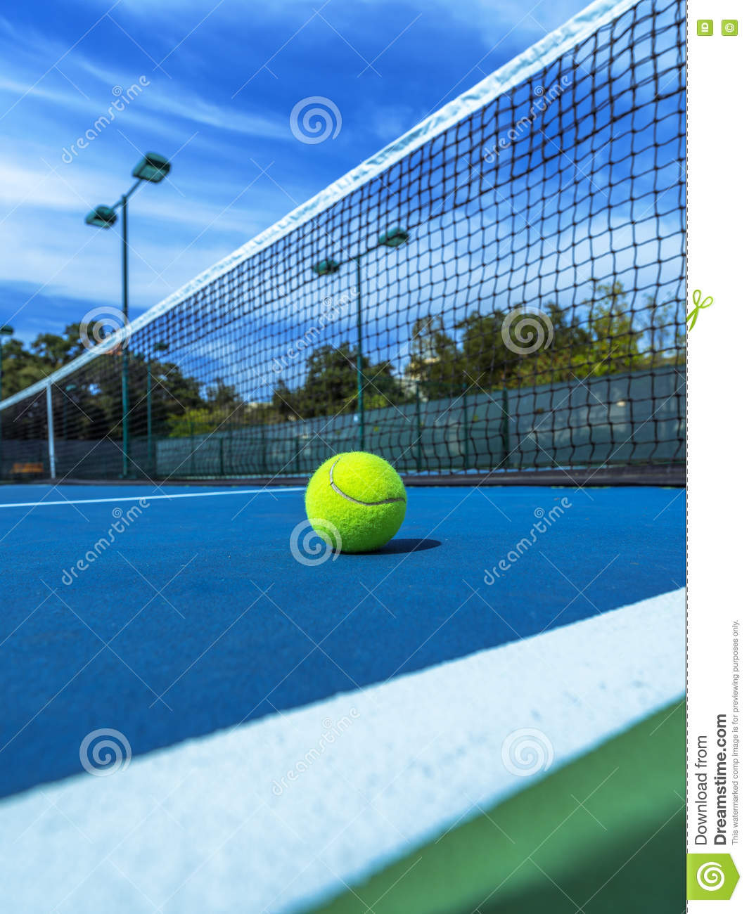 Tennis Ball On Blue Court Doubles Sideline And Net Stock Image