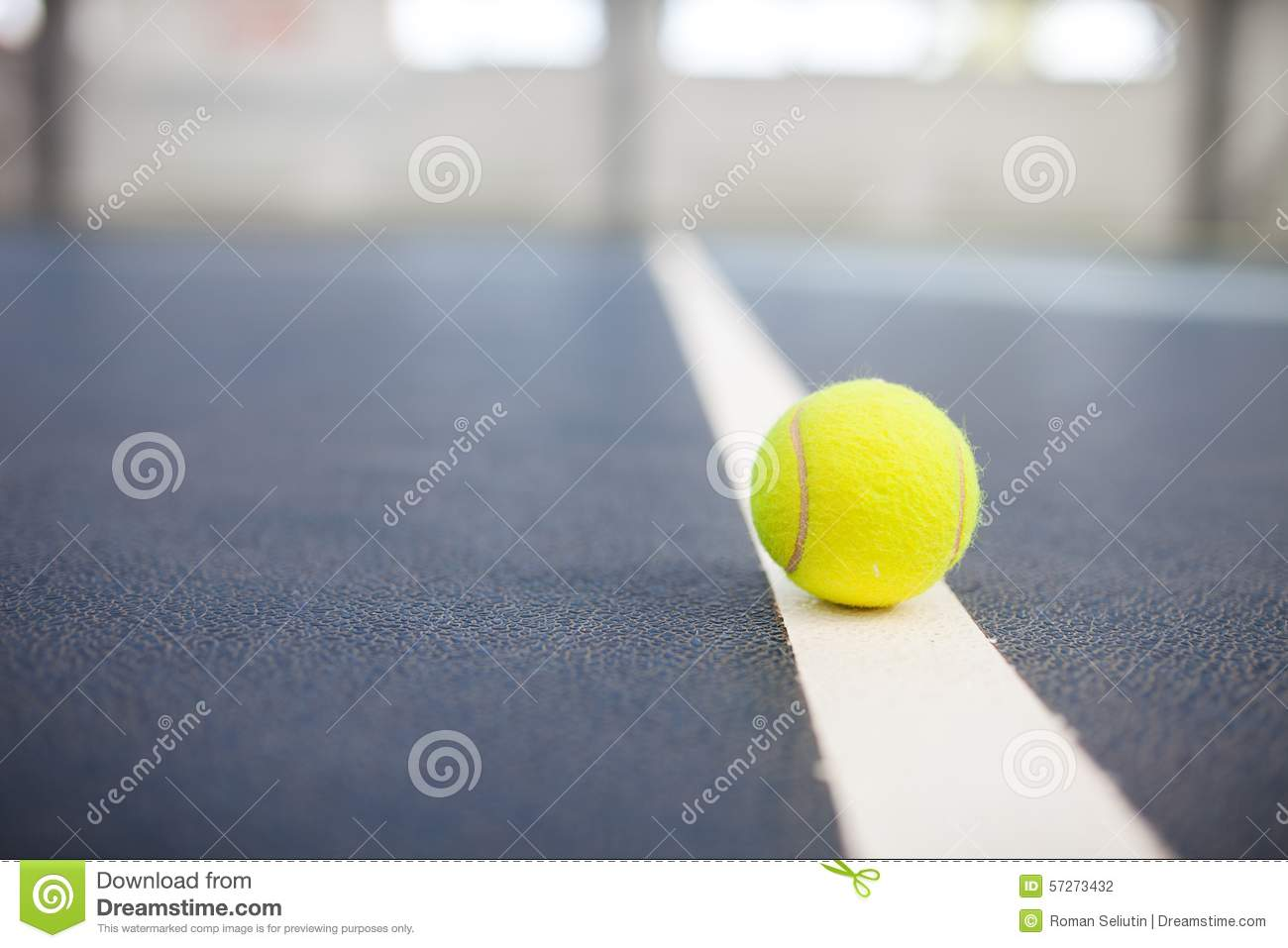 Tennis Ball on the Court Close up with room