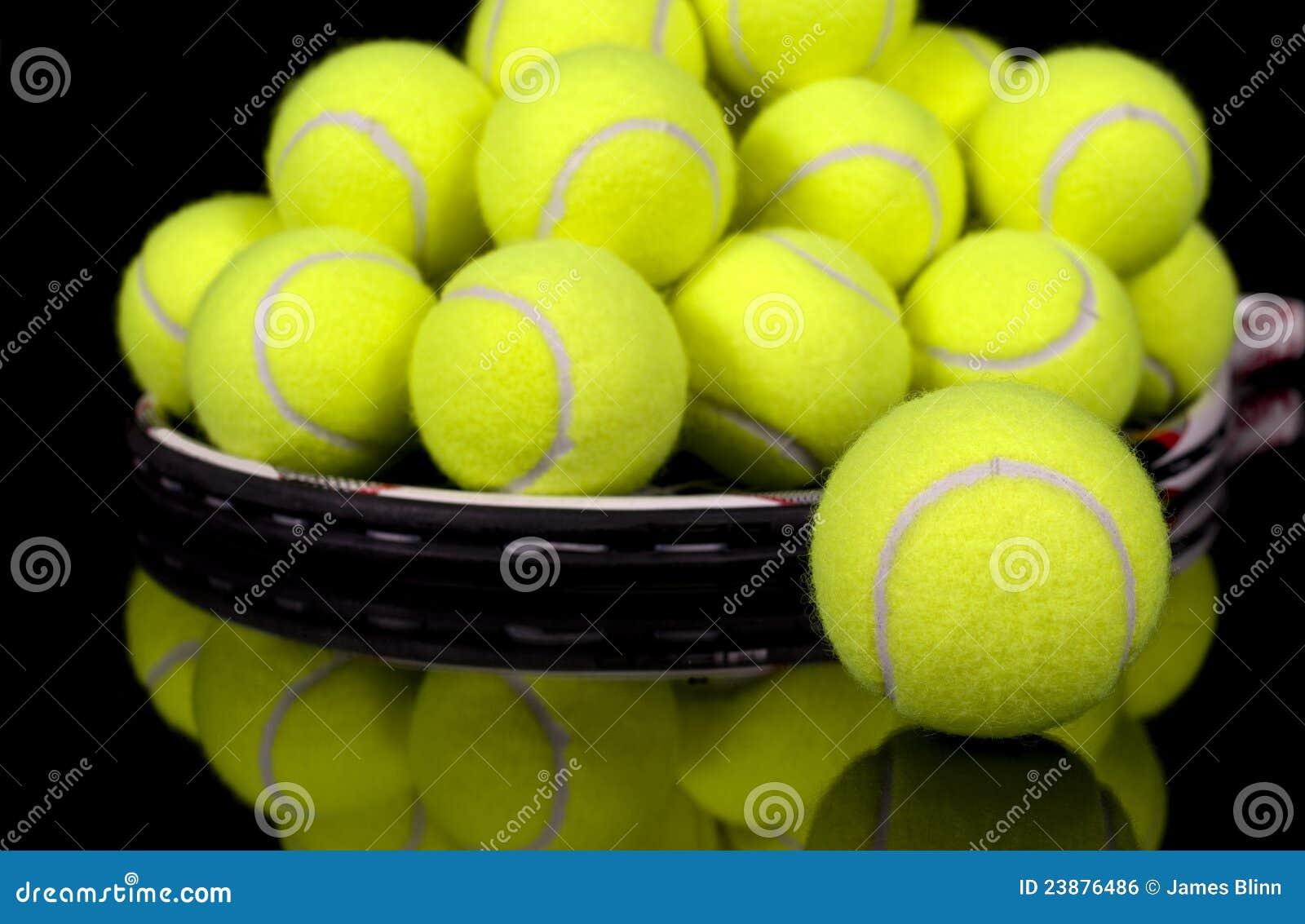 Tennis balls collected on tennis racket