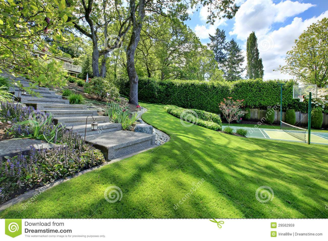 Tennis Court With House Landscape And Bright Green Grass Stock