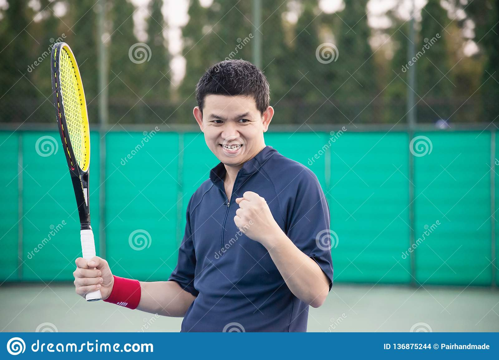 Tennis player expresses his victory in the game