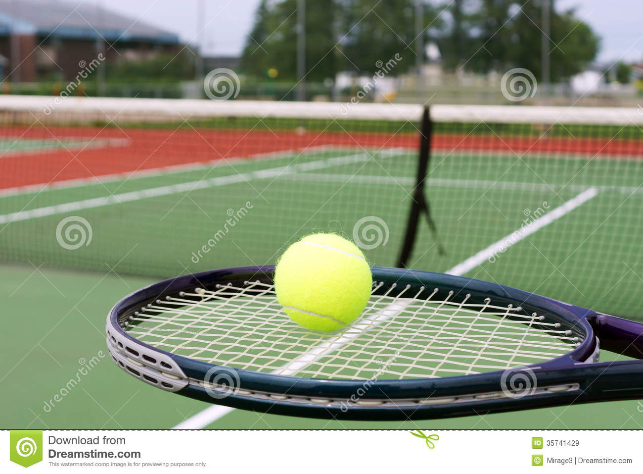 Tennis racket and ball on court