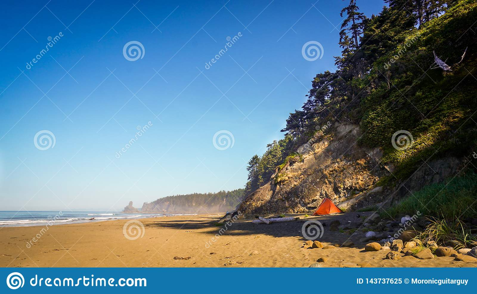 Tent at the beach by cliff