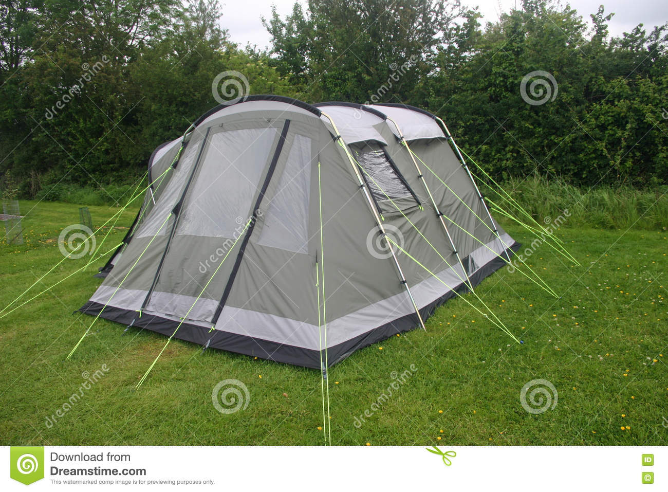 Grey and green four person tent with black sown-in groundsheet. Well guyed with bright yellow guy ropes. Erected on a grass area with trees and sky in the ... & Tent with guy ropes stock photo. Image of grass black - 79817904