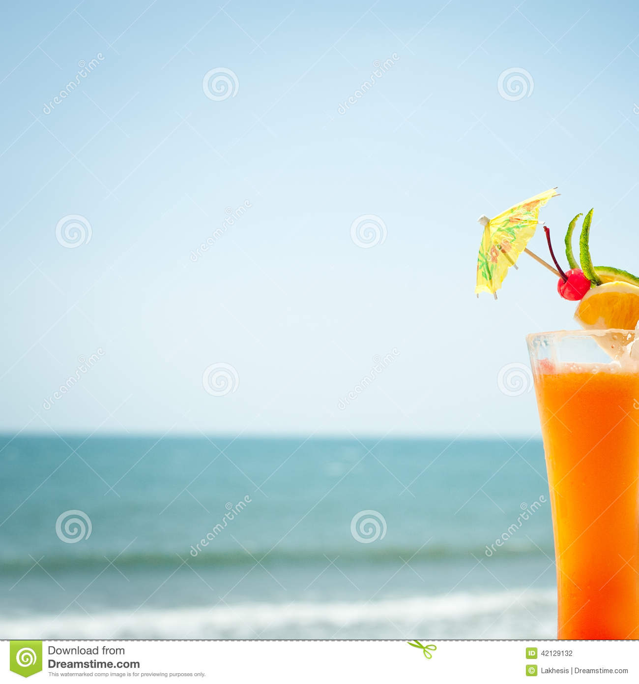 Tequila Sunrise Cocktail With Fruits And Umbrella