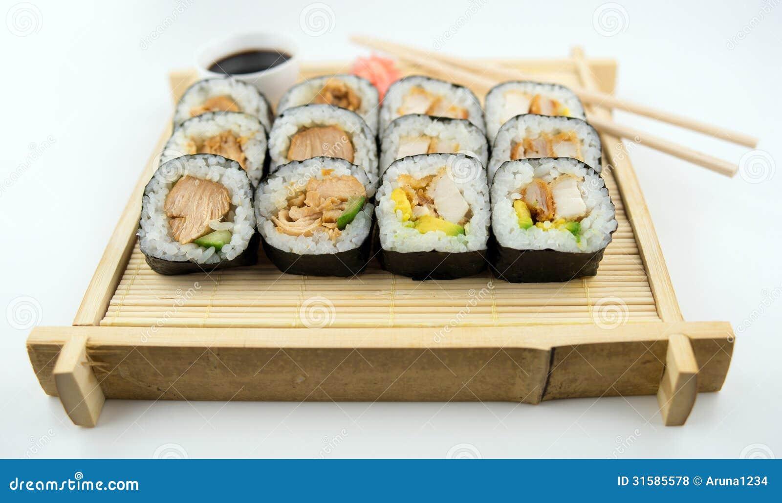 Teriyaki And Fried Chicken Sushi Rolls On Japanese Bamboo