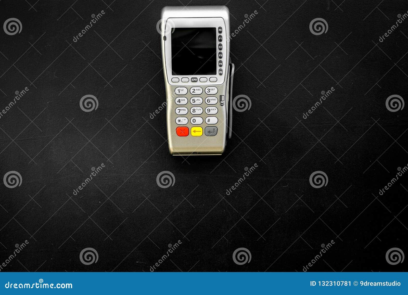 Terminale di pagamento, terminale compatto di posizione sullo spazio nero di vista superiore del fondo per testo