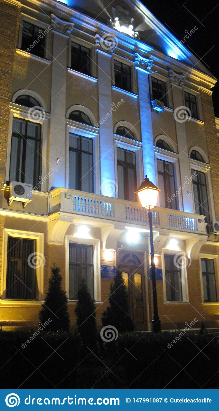 Ternopil, Ukraine - March 14, 2008: The city council building is highlighted in the evening by the national colors of Ukraine
