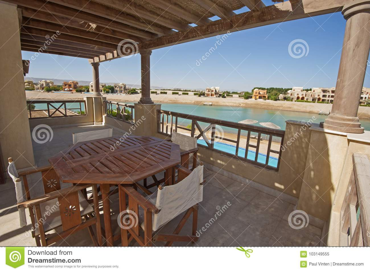 Terrace Balcony With Chairs And Table At Tropical Luxury Apartme