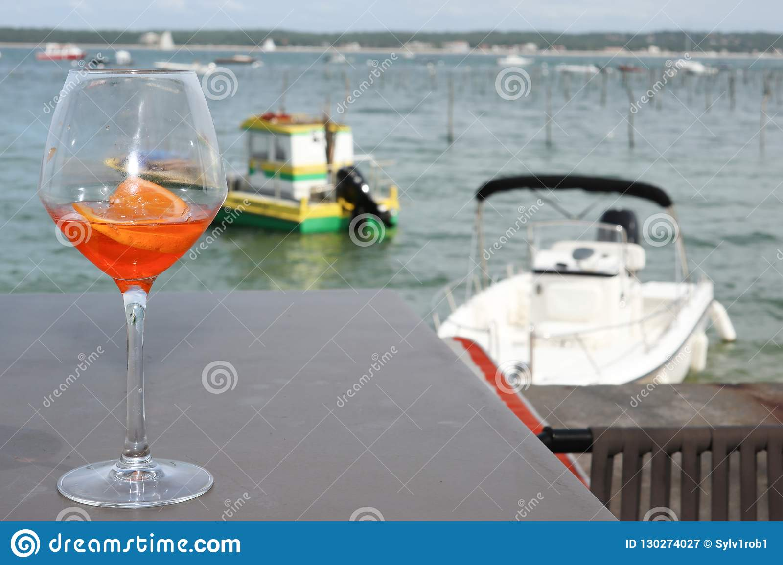 terrace at the beach at Cap Ferret in Arcachon, France with a glass of wine and local boat