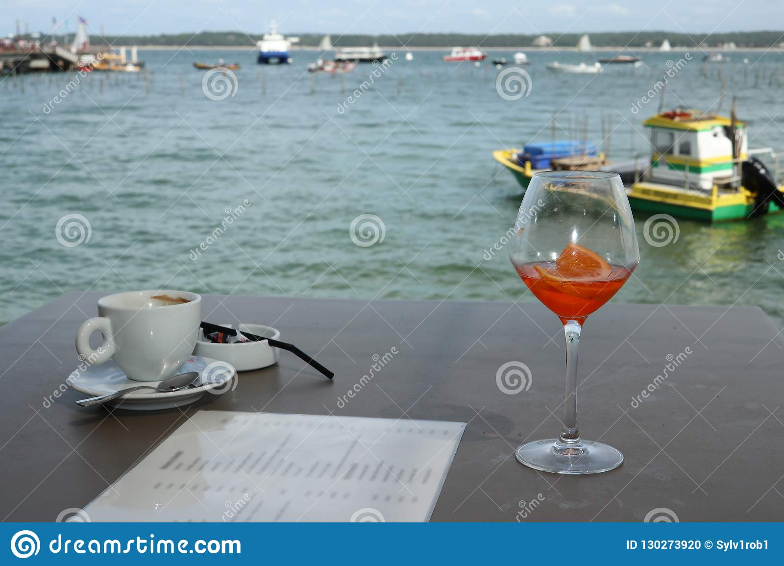 Terrace at the beach at cap ferret with a glass of wine and a coffee