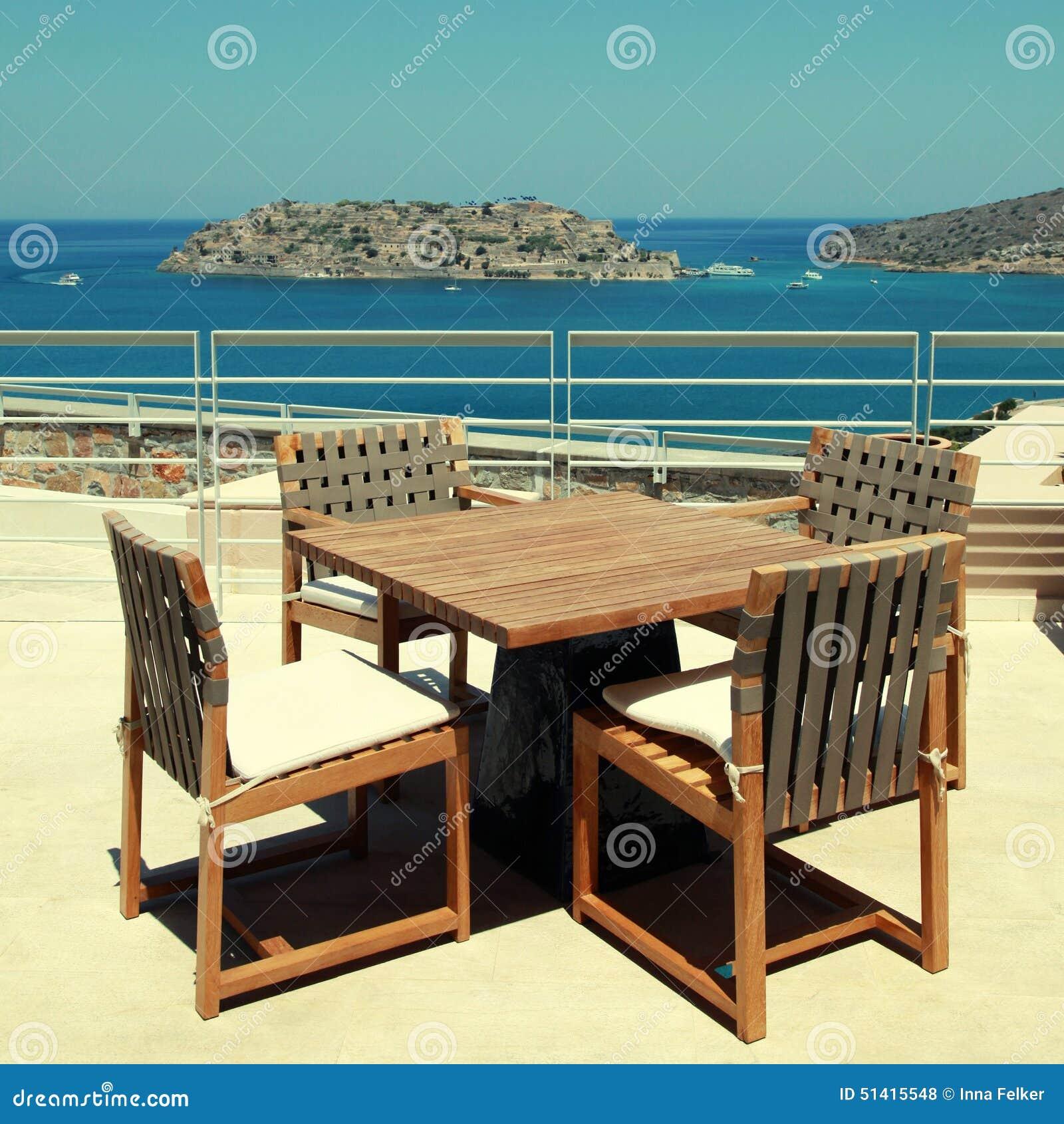Terrace seaview with outdoor furniture in a luxury resortcrete greece