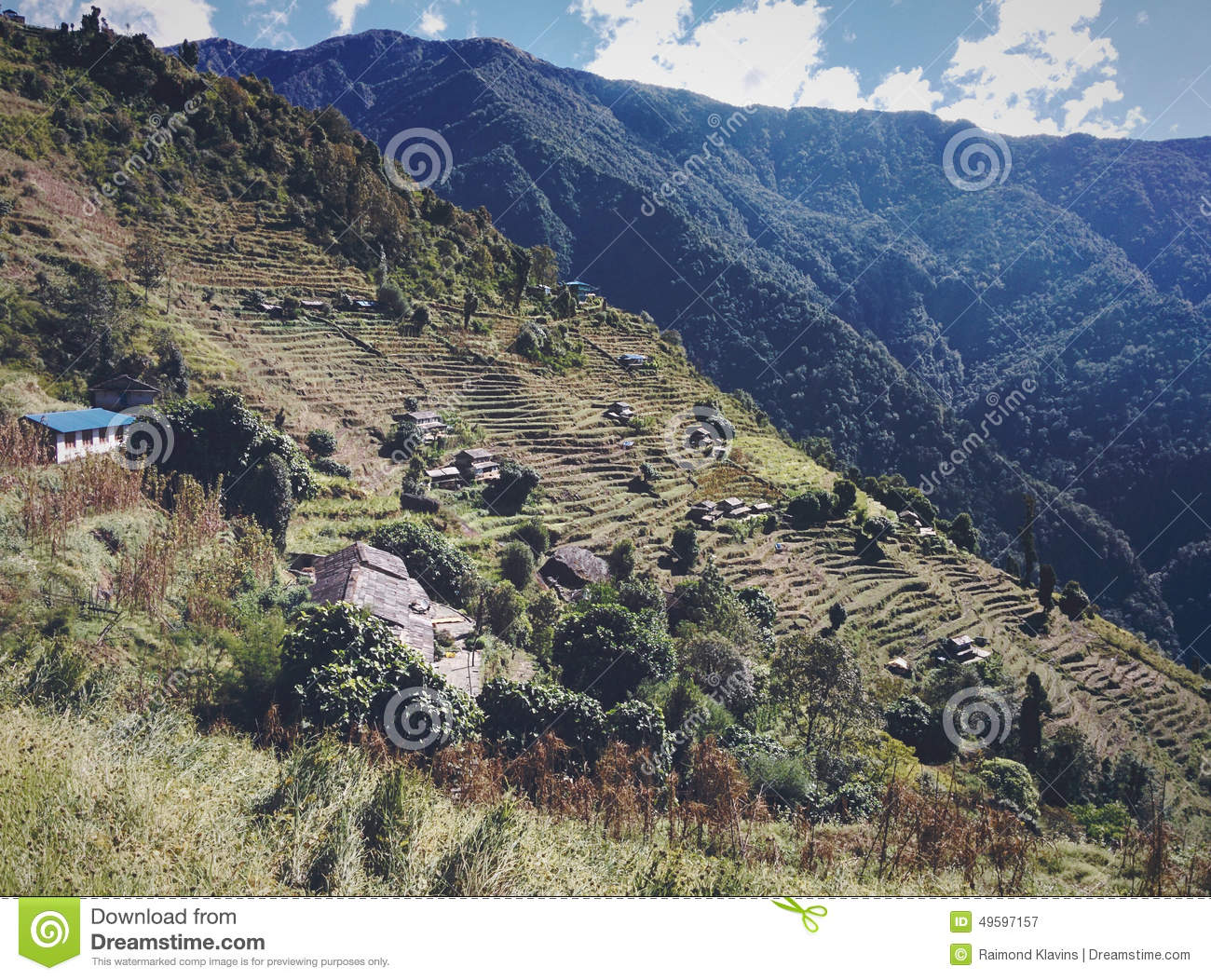 Terraces in Mountains with Clouds and Valley