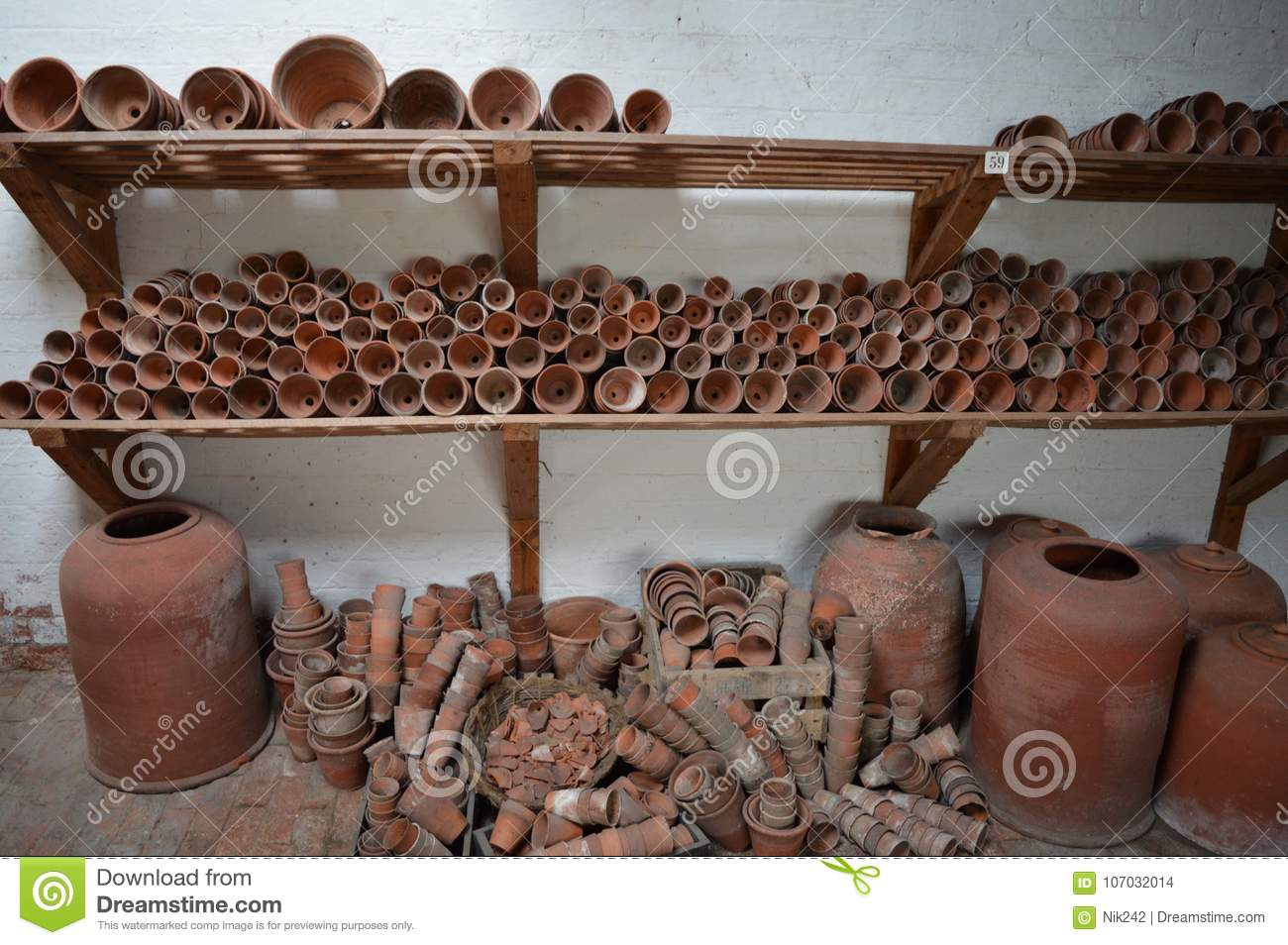 Terracotta Gardening Pots Stacked On Shelves