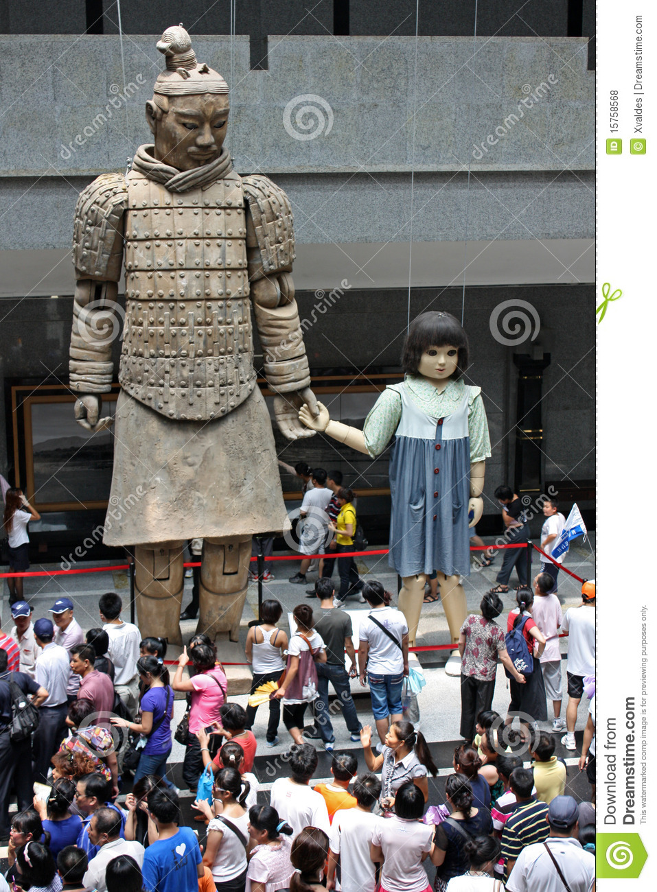 Big terracotta warrior Statue holding hands with a girl puppet in the ...