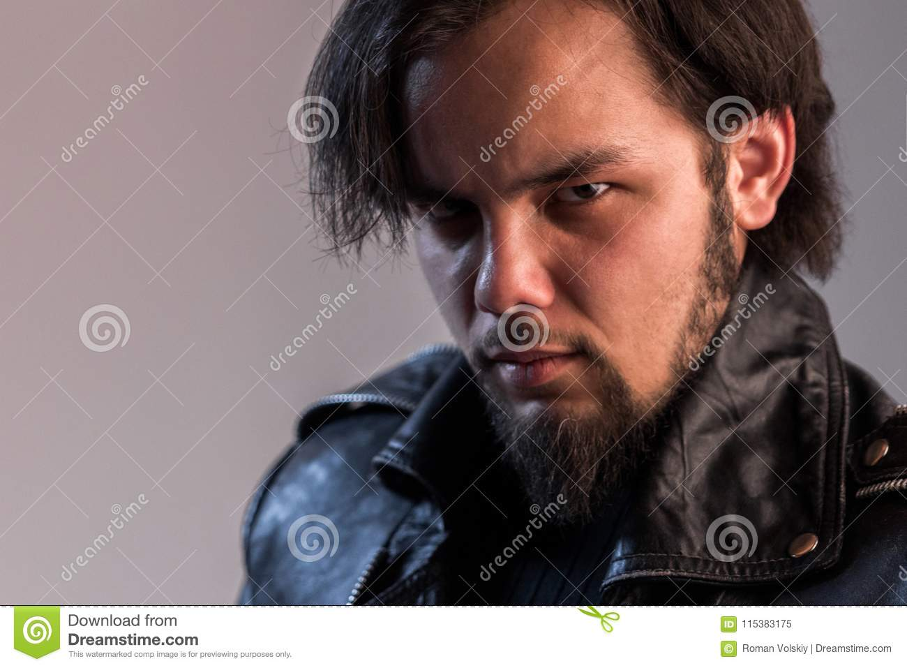 Terrible Look Of The Guy With A Beard In A Black Leather Jacket
