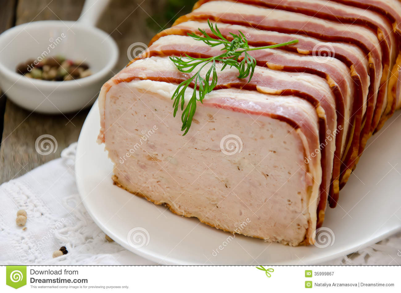 terrine of turkey and pork wrapped in bacon royalty free