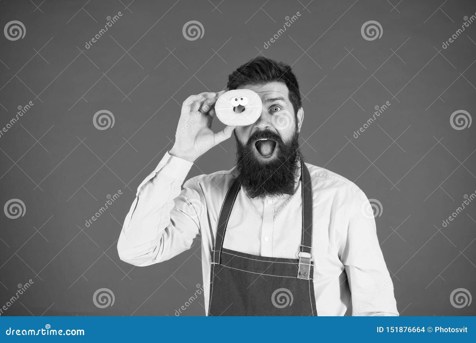 ?tes vous ce que vous mangez Beignet de prise de Baker Hippie dr?le Cuisinier barbu d homme Homme de chef en caf? R?gime et nourr