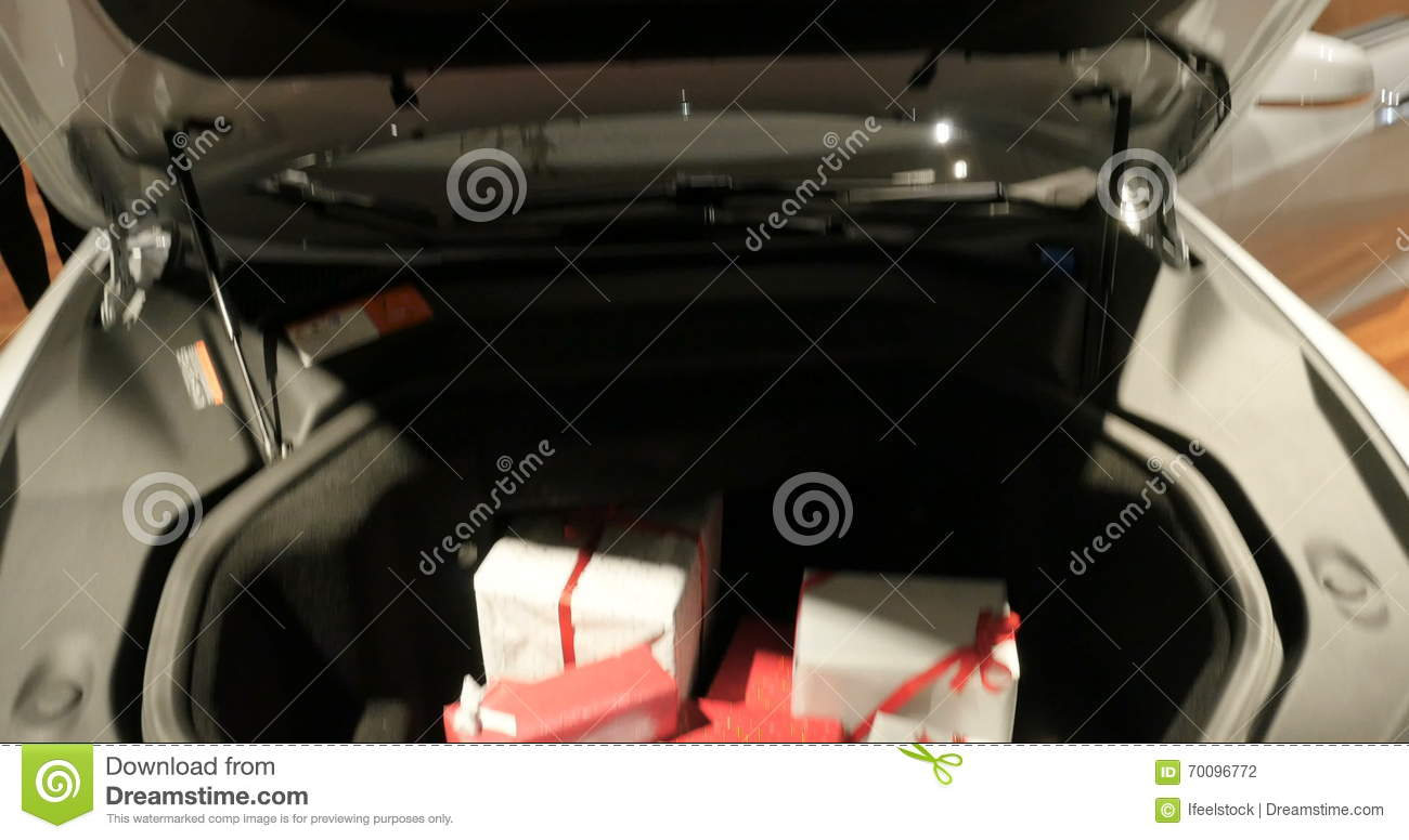 Tesla Car With Trunk Filled With Gift Boxes Stock Footage - Video of