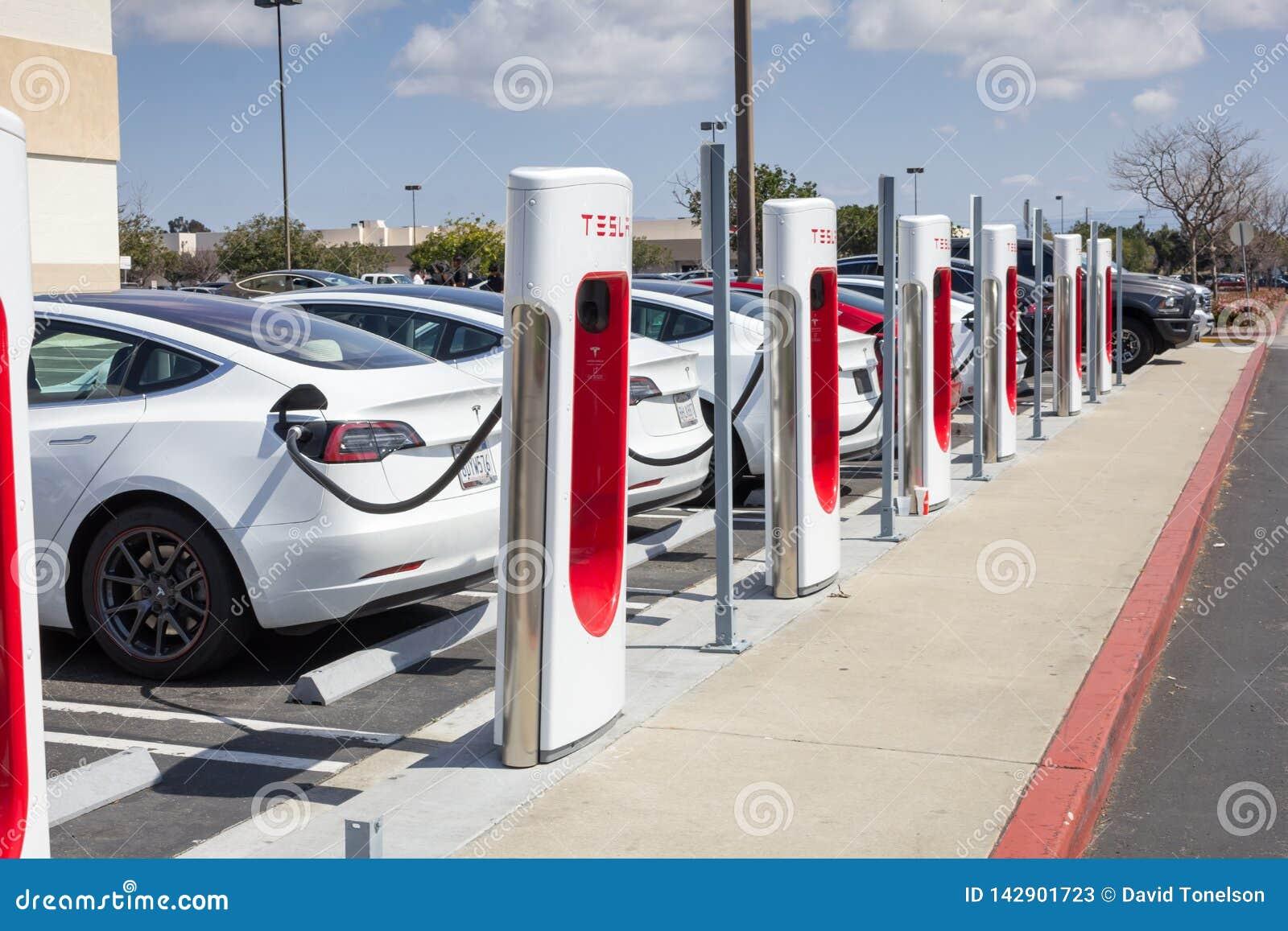 Tesla charging station pumps