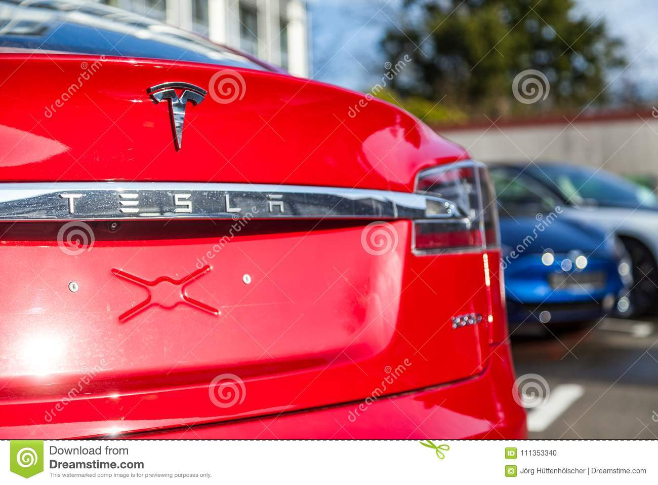 Tesla logo on a Tesla car