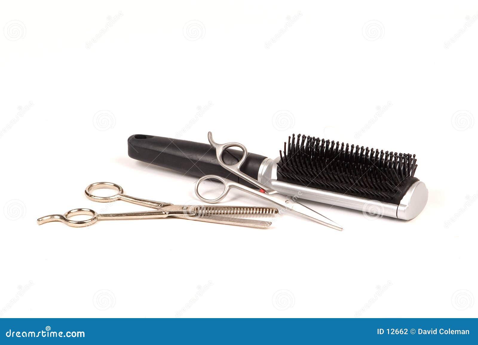 Tesouras e escova do cabelo