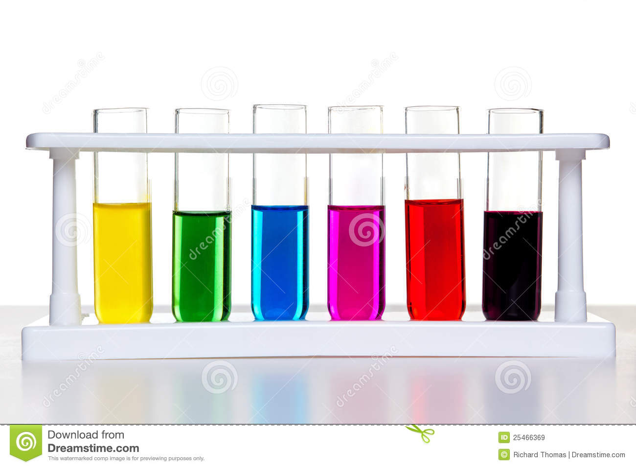 Photo of test tubes full of chemicals in a rack on a white background.