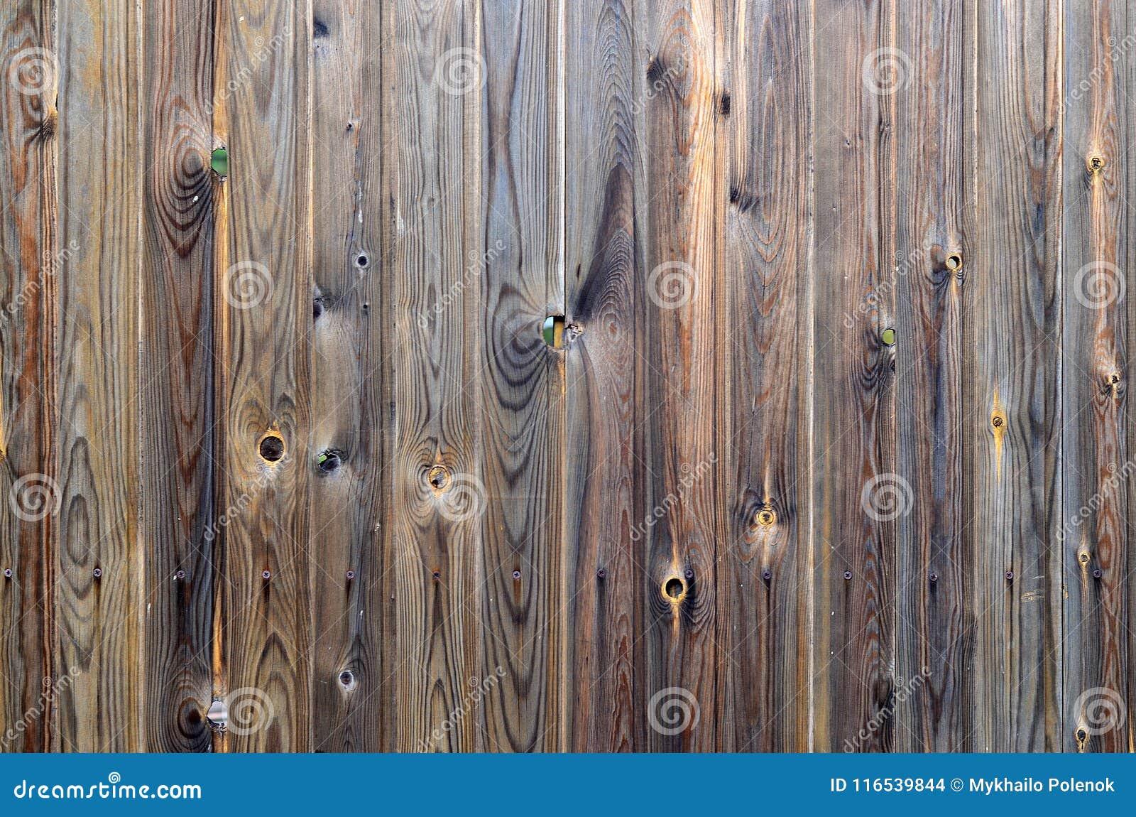 Teste padrão de madeira velho do painel do marrom escuro do grunge com textura abstrata bonita da superfície da grão, fundo listr