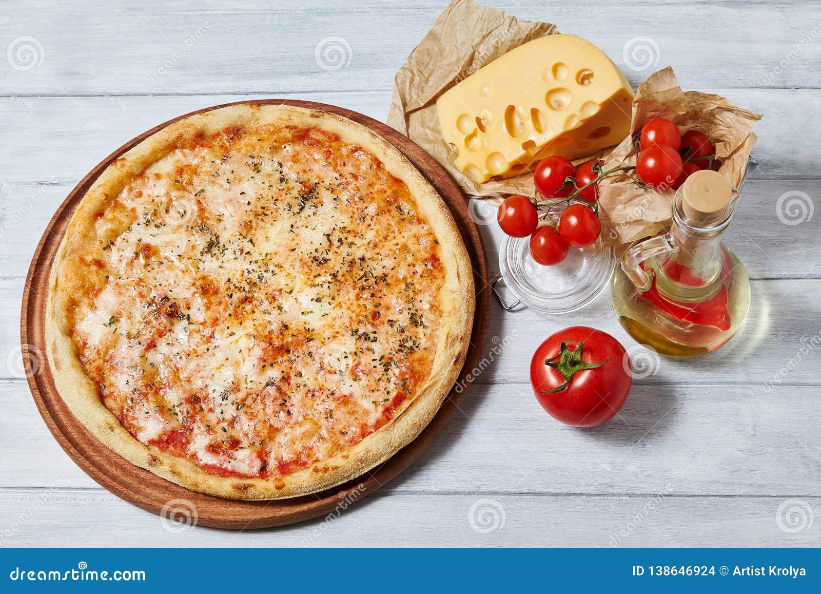 Testy margarita pizza with  tomato sauce, mozzarella