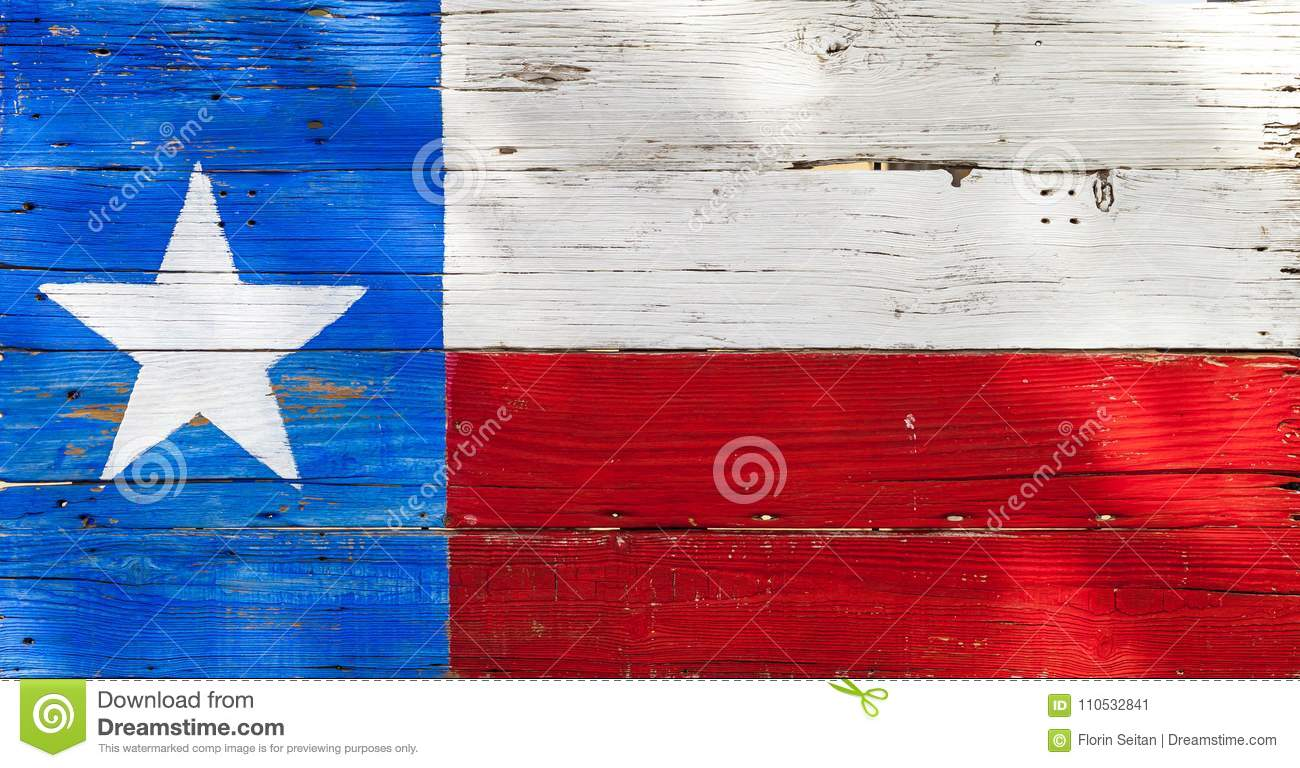 Texas flag painted on rustic weathered wooden boards