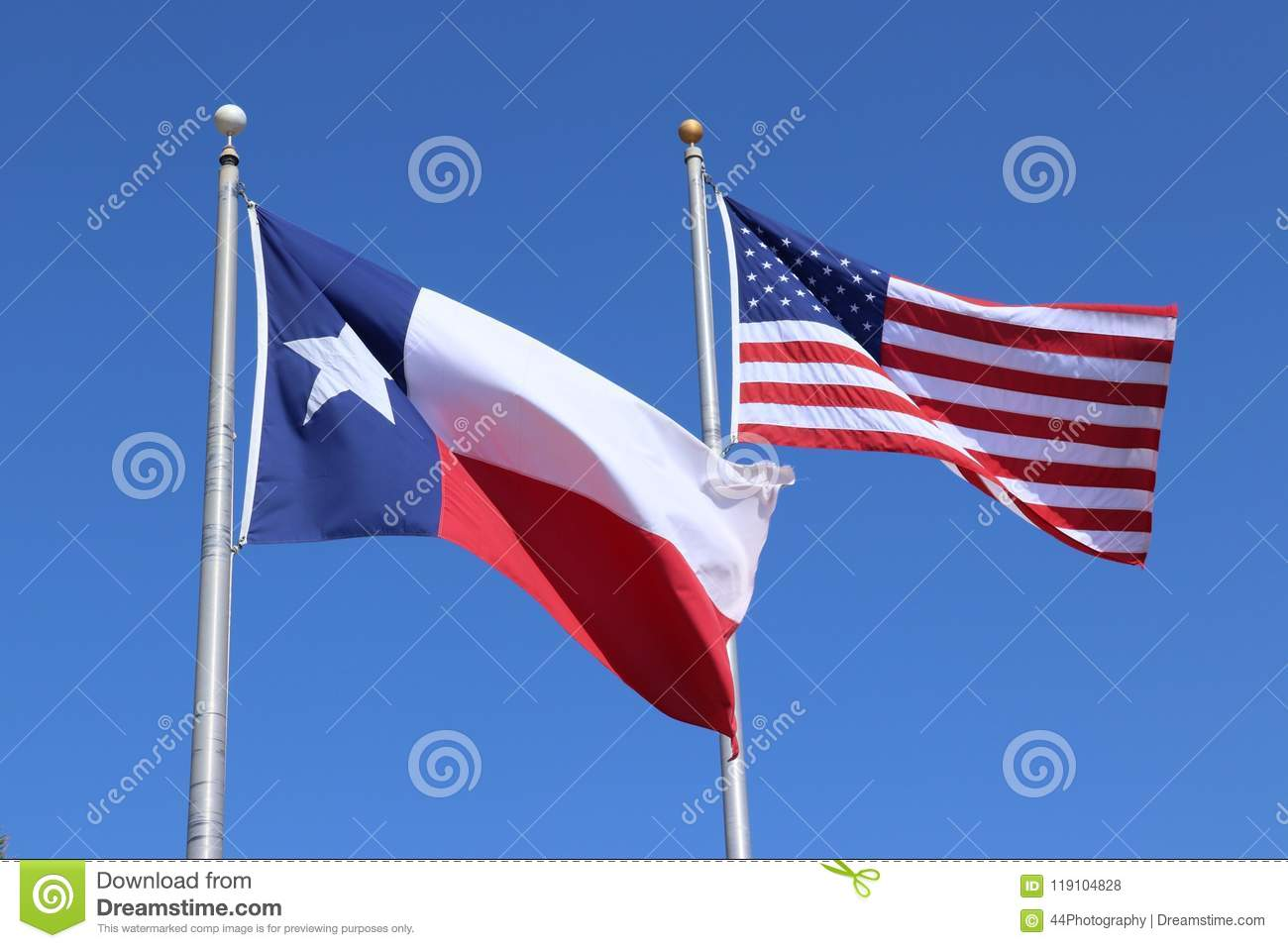 Texas flag, Lone Star State flag and United States of America US flag against clear blue sky background