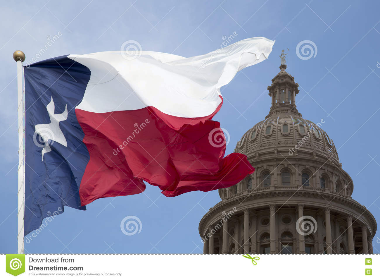 Texas state capital and waving flag
