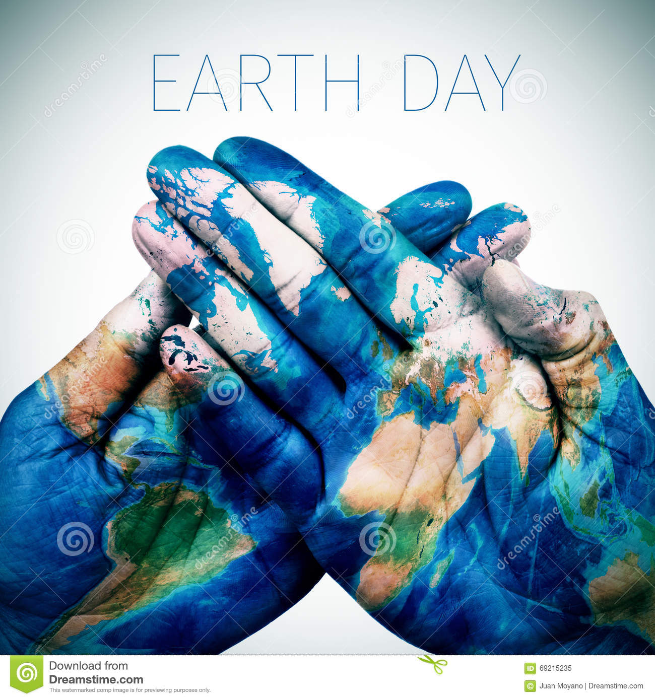 text earth day and man hands patterned with a world map (furnished by NASA)
