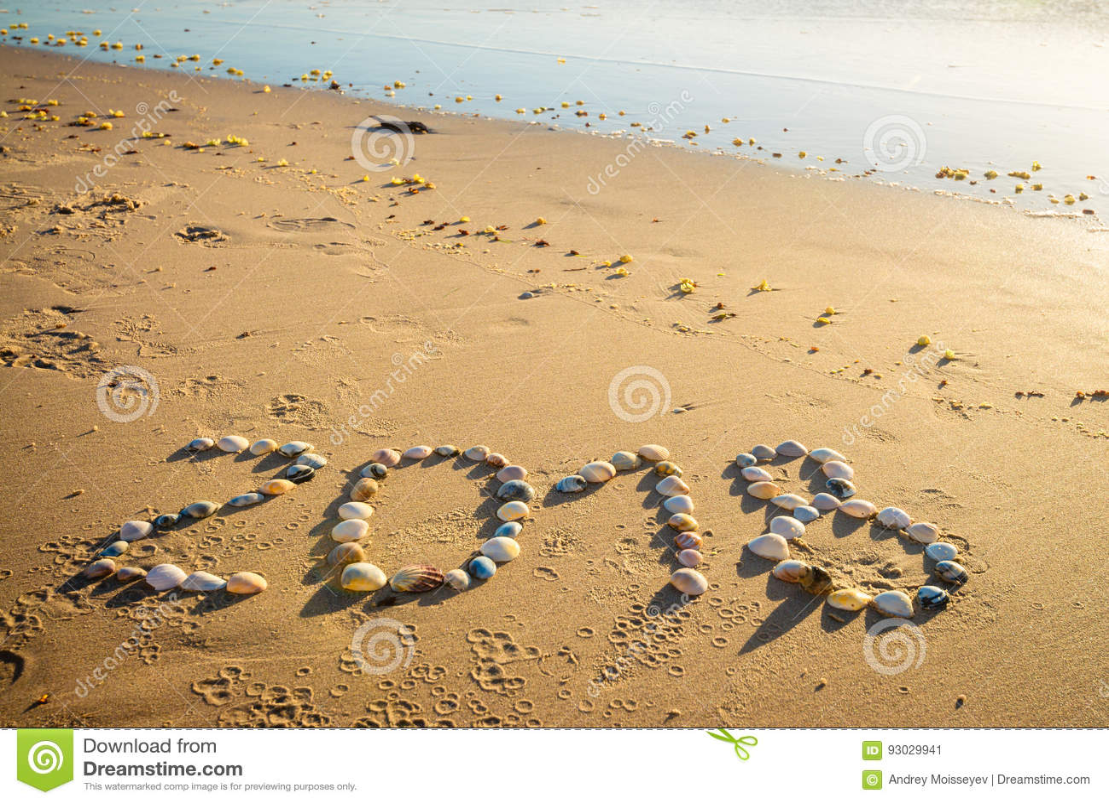 Text för nytt år 2018 på sand