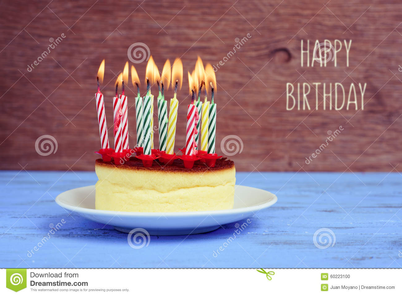 Text Happy Birthday And Cheesecake With Lighted Candles Stock Photo