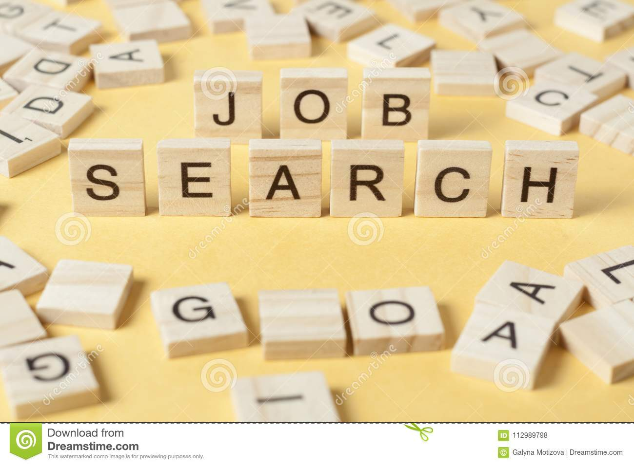 Text JOB SEARCH on wooden cubes at yellow background.