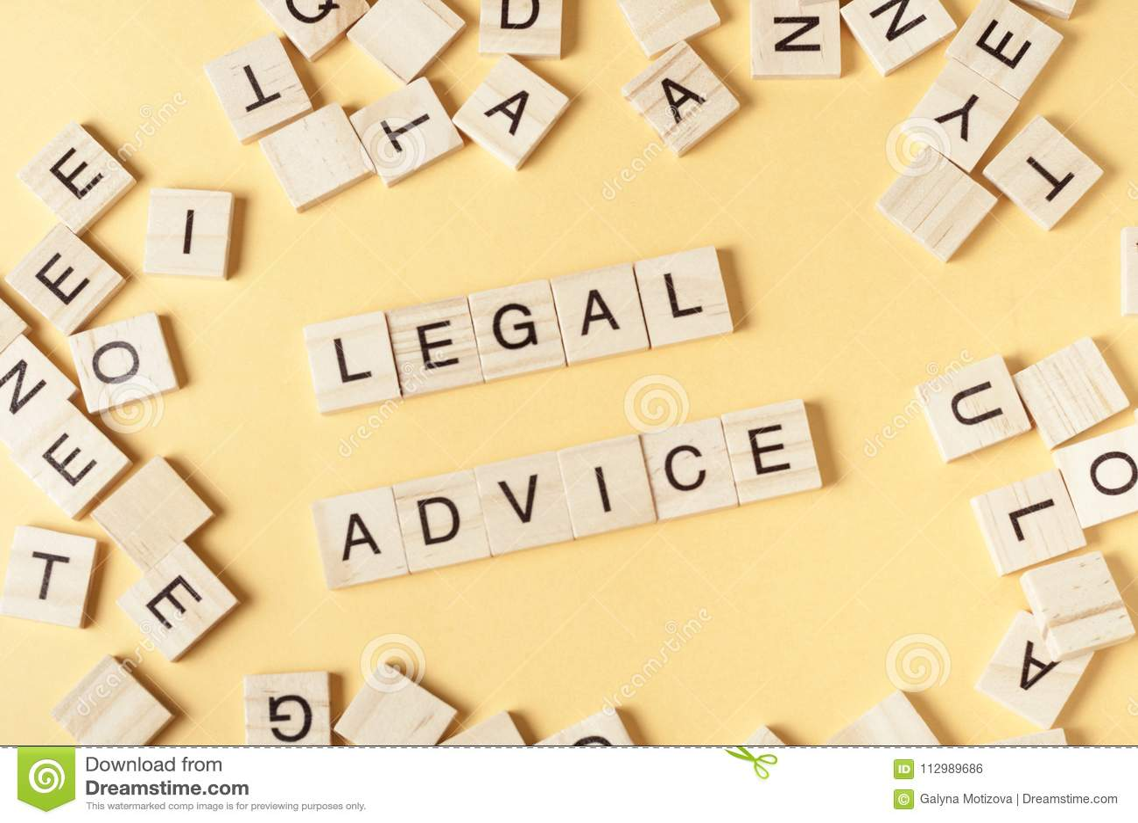 LEGAL ADVICE written on wood block. Wooden ABC.