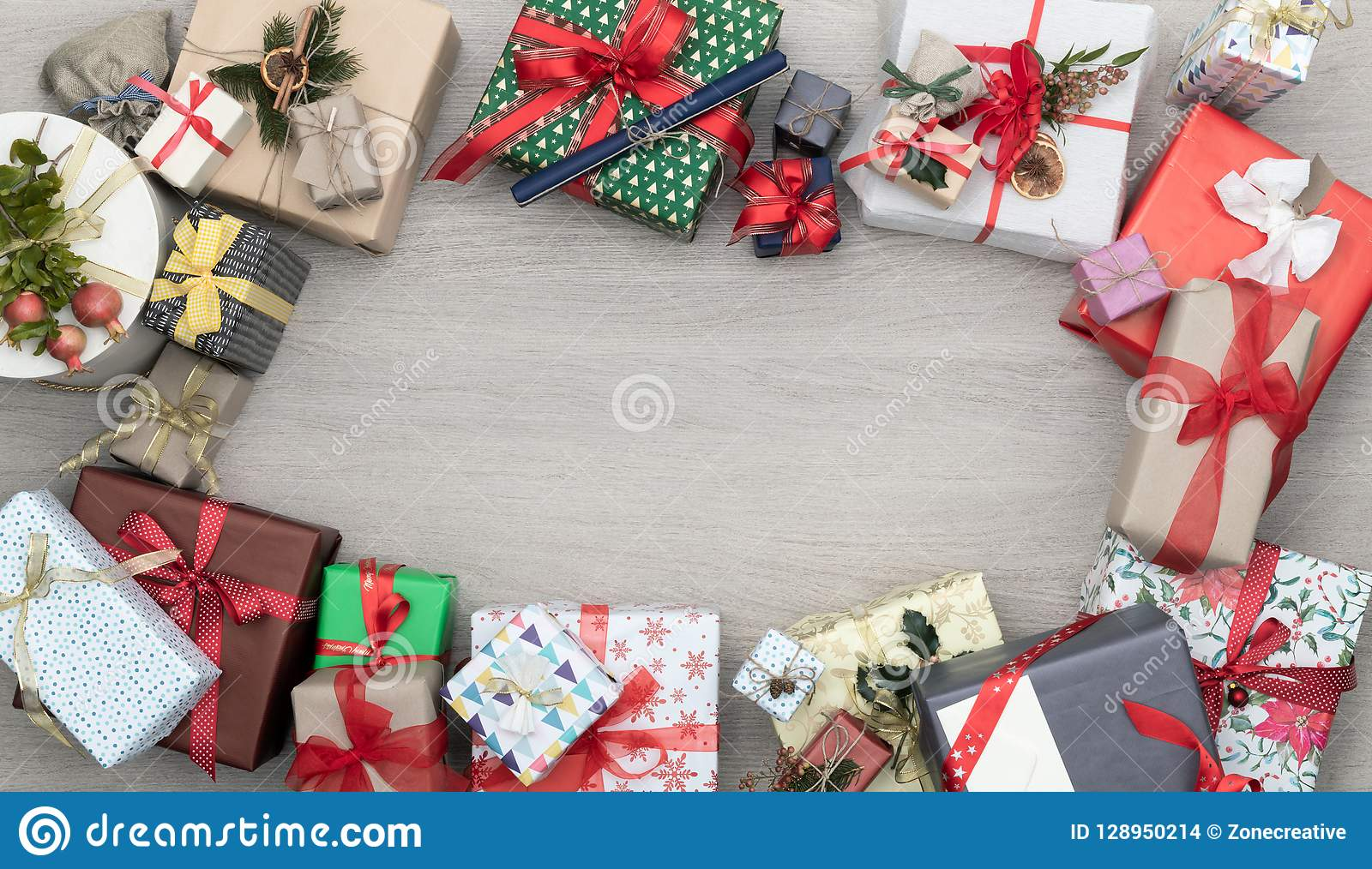 Text or logo empty copy space in vertical top view wooden table full of christmas or birthday gifts presents.Xmas winter