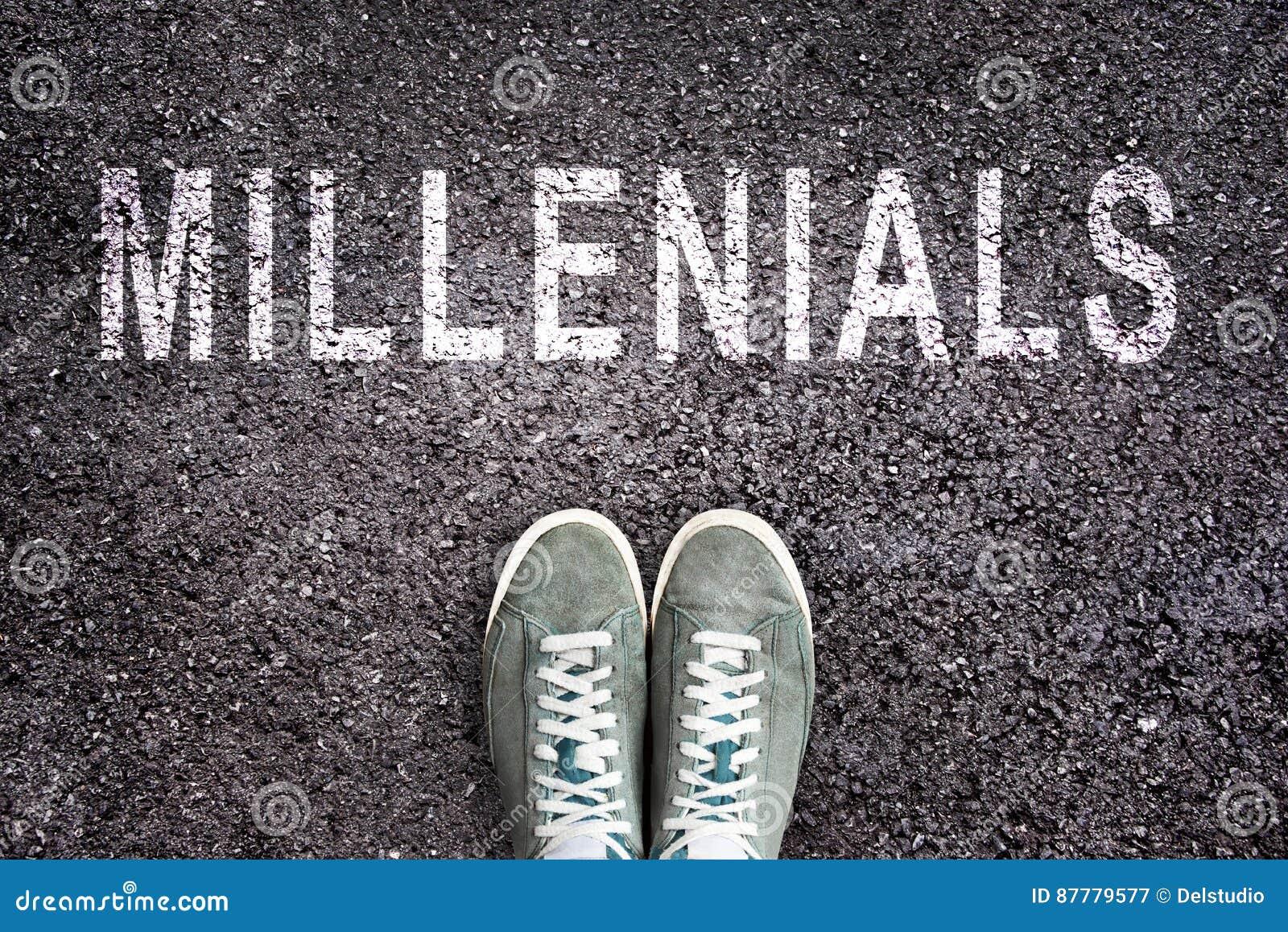 Text Millennials written on asphalt with shoes