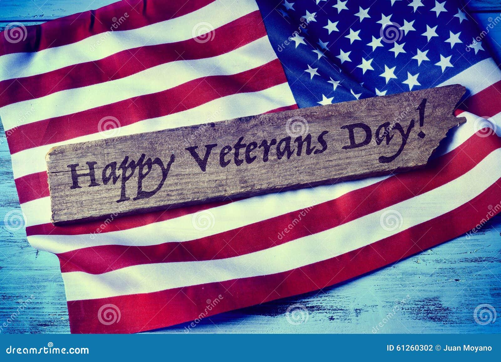 Text o dia de veteranos feliz e a bandeira dos E.U.