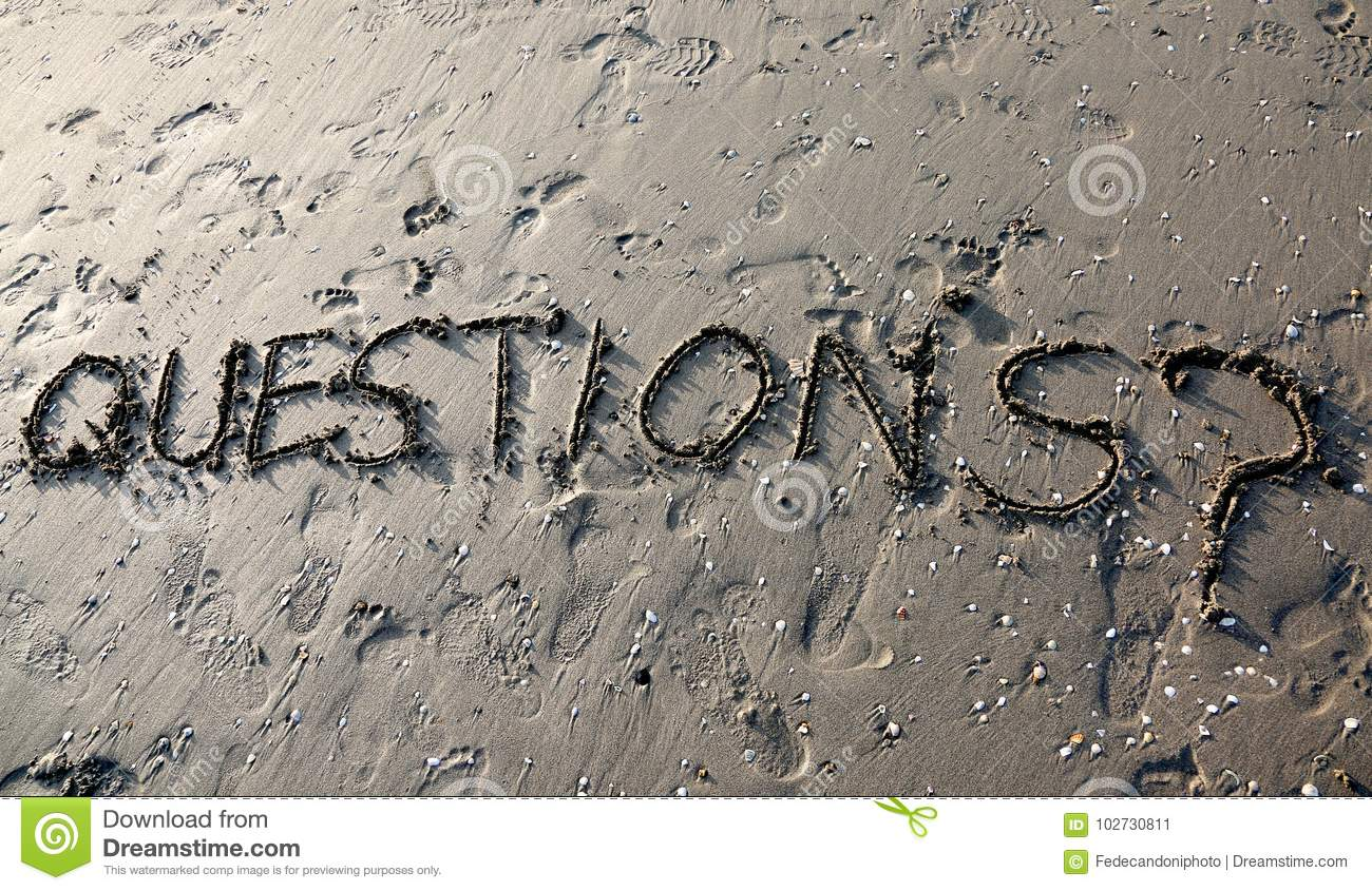 Text QUESTIONS with question mark written on the sand can be use
