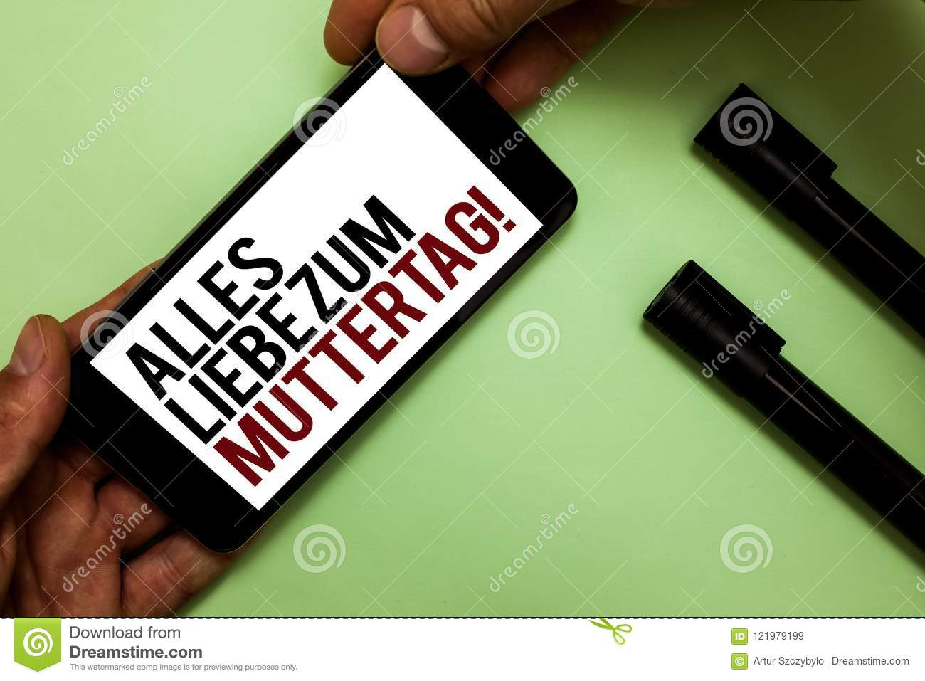 Text sign showing alles liebe zum muttertag conceptual photo happy conceptual photo happy mothers day love good wishes affection mans hand hold phone with black and red words near two black marker m4hsunfo