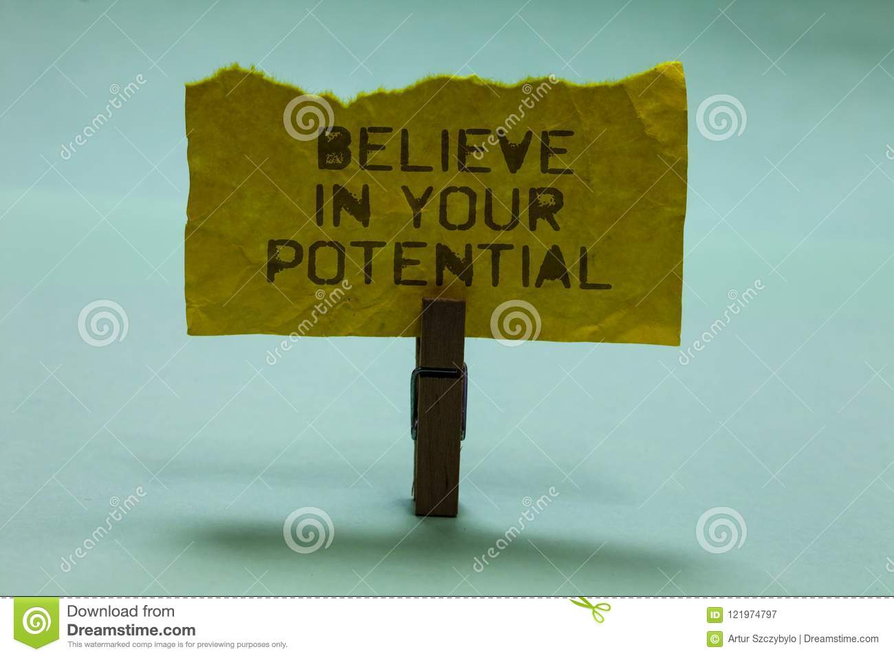 Text sign showing Believe In Your Potential. Conceptual photo Have self-confidence motiavate inspire yourself Paperclip hold torn