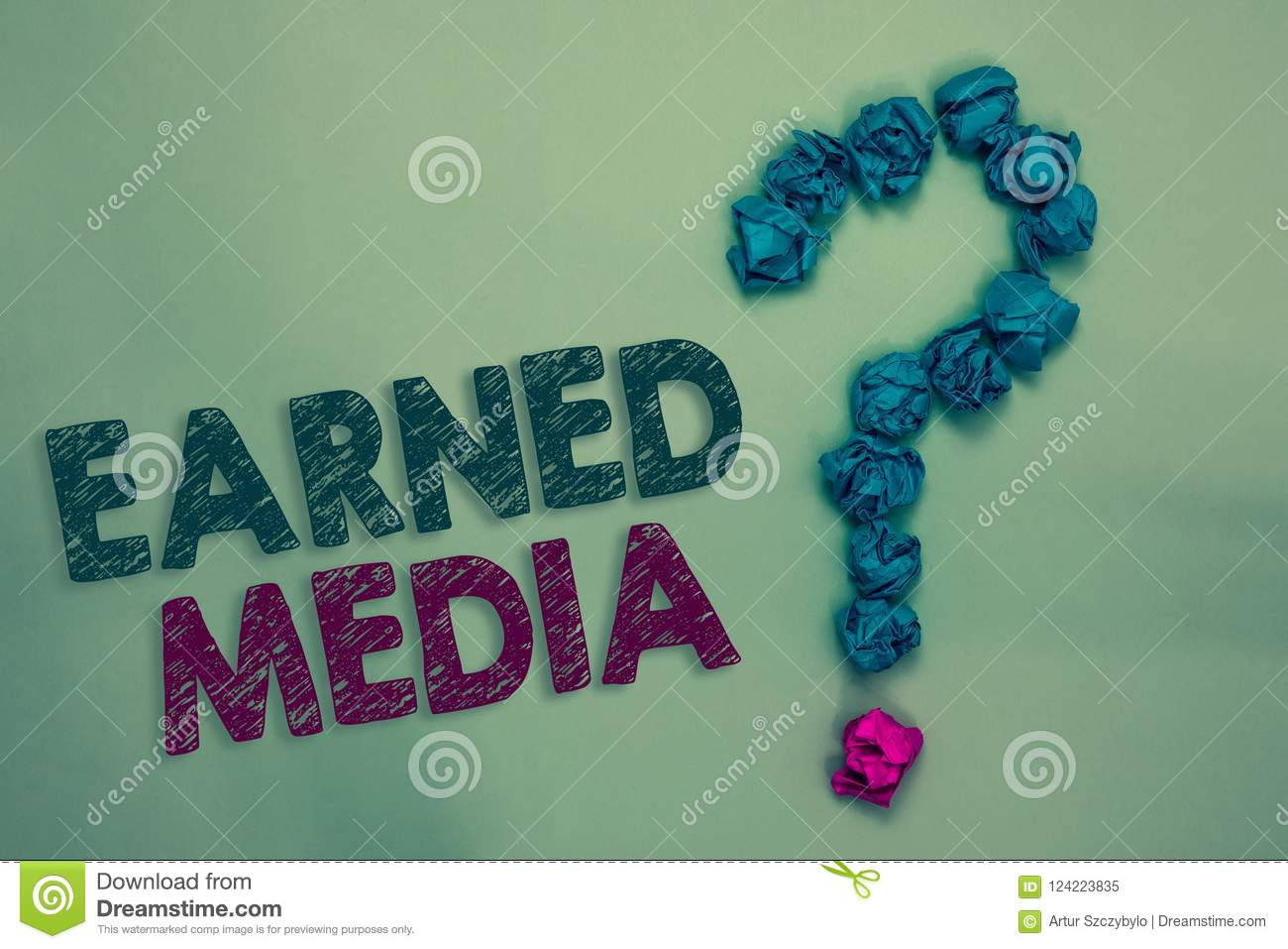 Text sign showing Earned Media. Conceptual photo Publicity gained through promotional efforts by multimedia Crumpled papers formin
