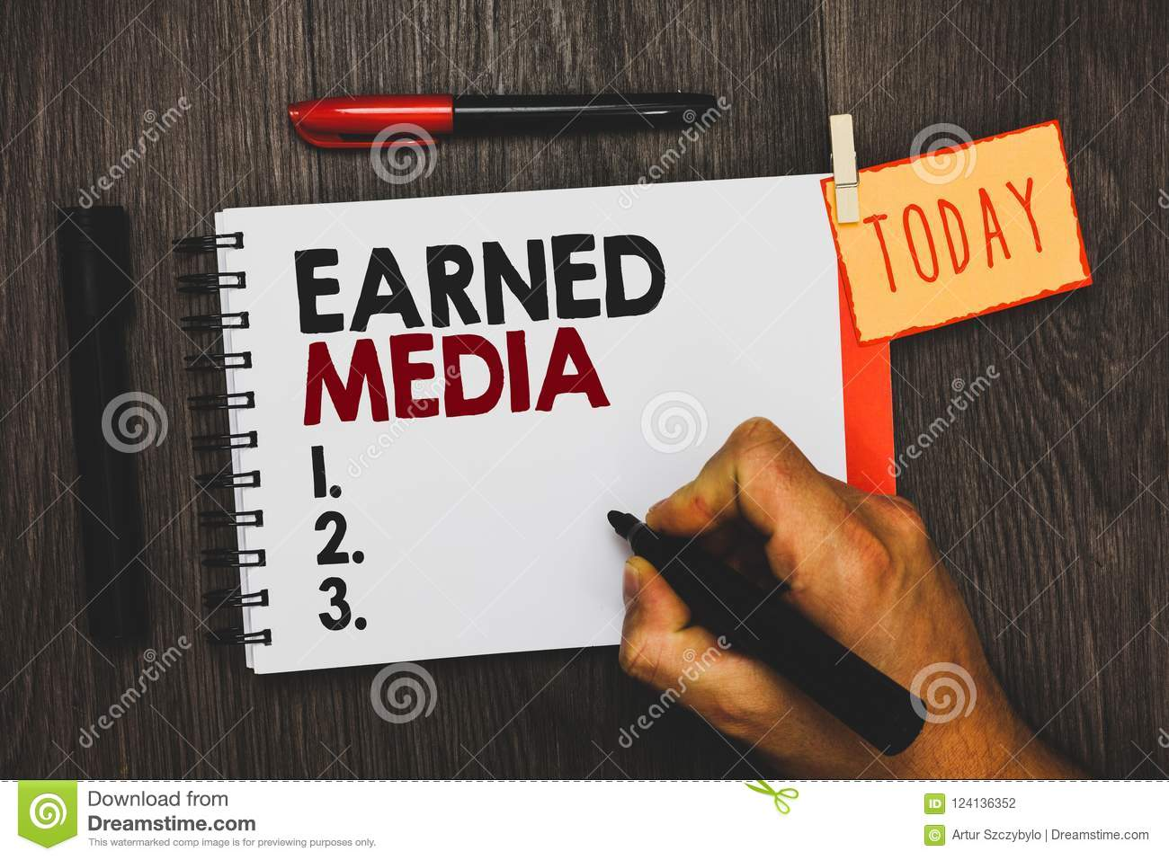 Text sign showing Earned Media. Conceptual photo Publicity gained through promotional efforts by multimedia Man holding marker not