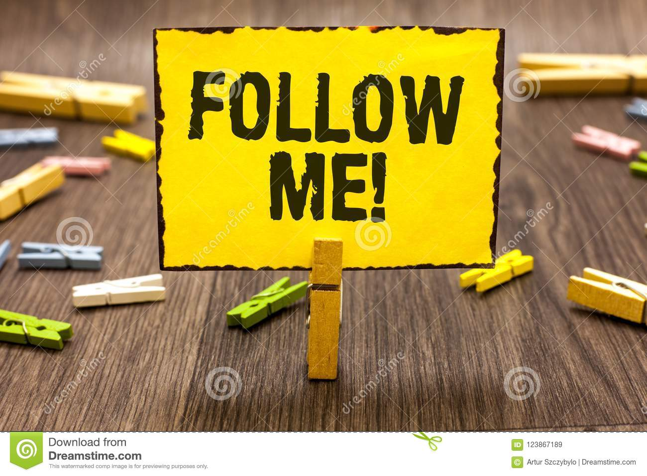 Text sign showing Follow Me. Conceptual photo Inviting a person or group to obey your prefered leadership Clothespin holding yello
