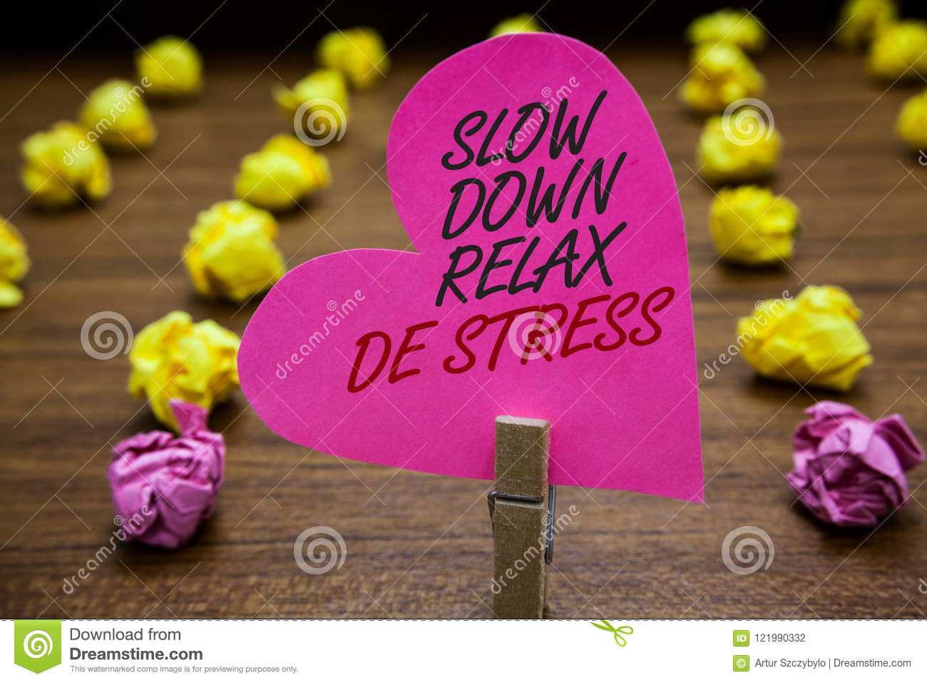 Text sign showing Slow Down Relax De Stress. Conceptual photo Have a break reduce stress levels rest calm Paperclip hold pink hear