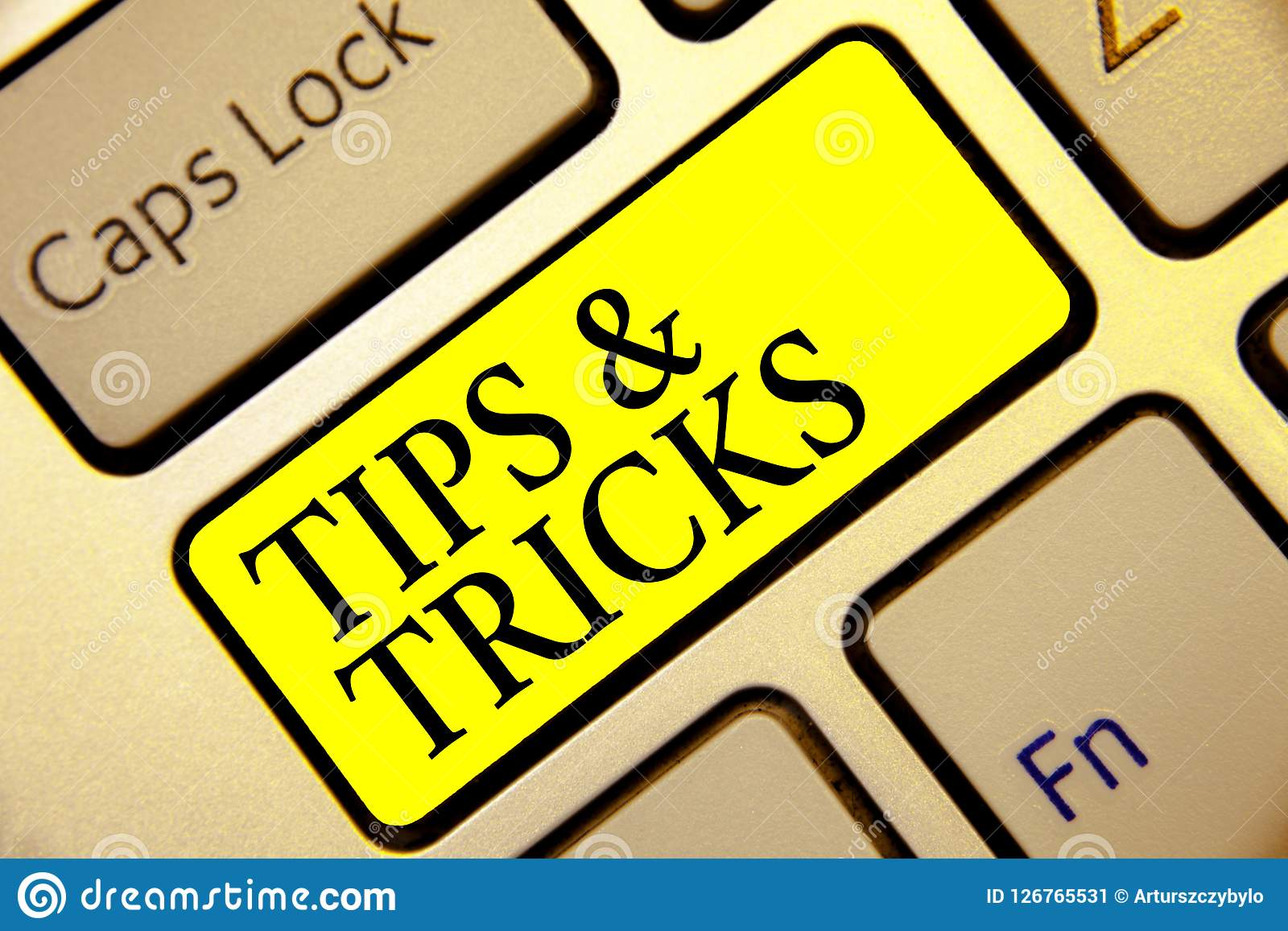 Text sign showing Tips and Tricks. Conceptual photo Steps Lifehacks Handy advice Recommendations Skills Keyboard yellow key Intent